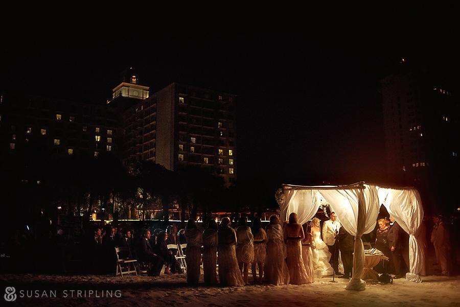 Nighttime beach wedding